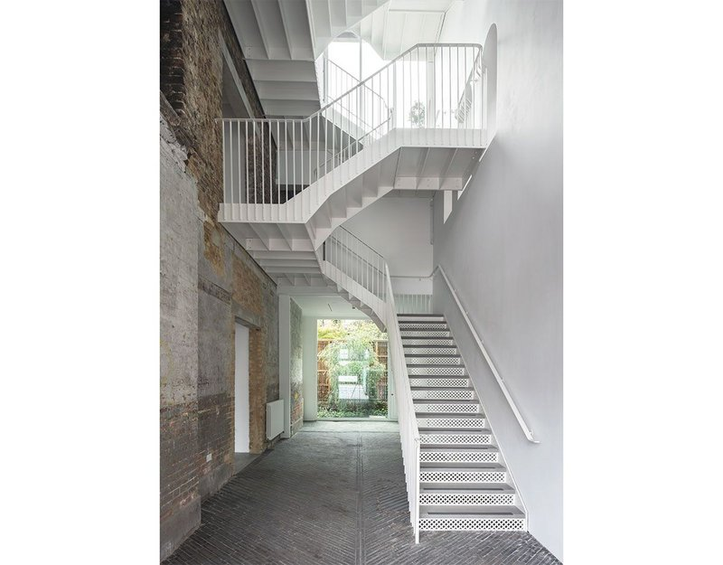 The staircase is the main formal move standing out against the general 'light touch' approach.