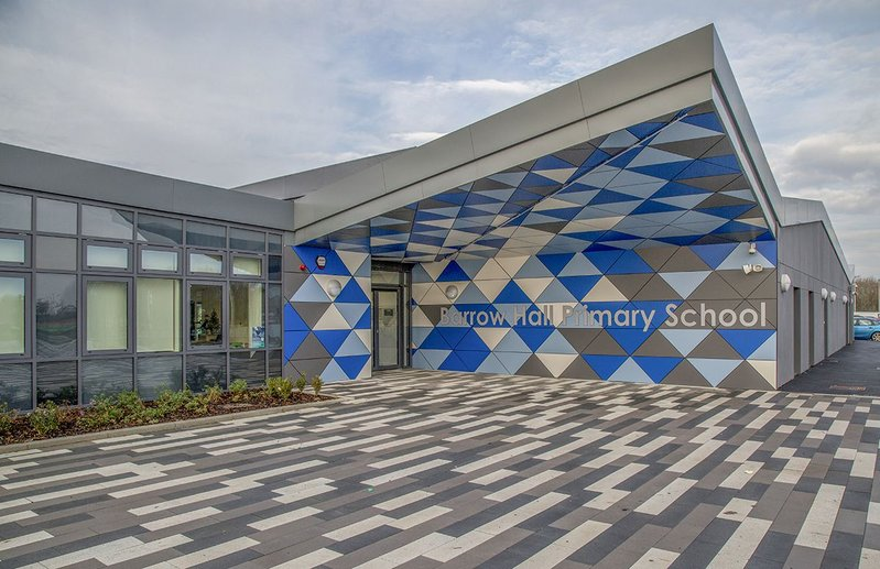 The new look Barrow Hall Primary School near Warrington designed by Ellis Williams Architects with its bright Formica Group rainscreen cladding.