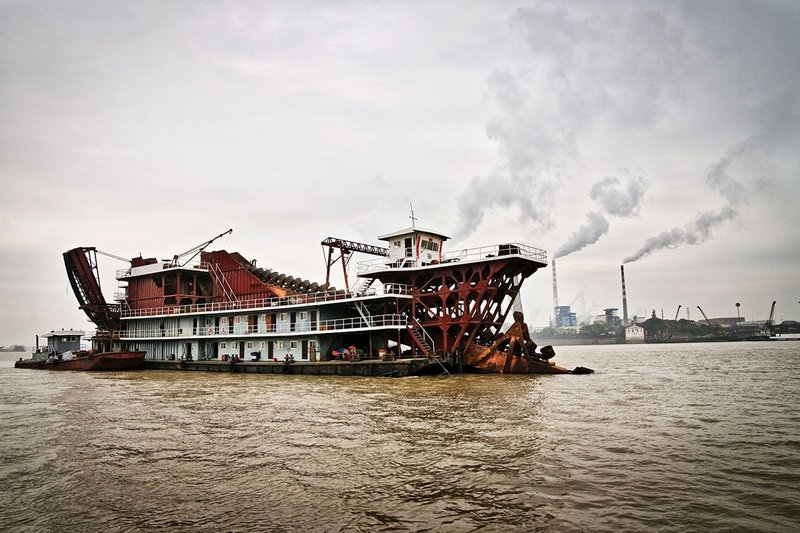 Sand dredging boats on Dongting Lake, China.