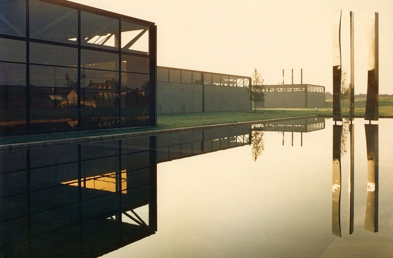 PJ Carroll's factory in Dundalk, County Louth. The ornamental lake with reflective mobile sculpture, 'Sails', by Gerda Froemmel.