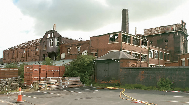 Image of ruined building caption: The Springfield brewery as handed over to Associated Architects.