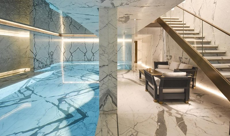 A pool and spa in the basement of a private residence in London where Biogel Extreme was used to fix Calacatta Oro marble slabs to metal with Biogel No Limits used elsewhere for the slabs, which were up to 1000x2000mm.