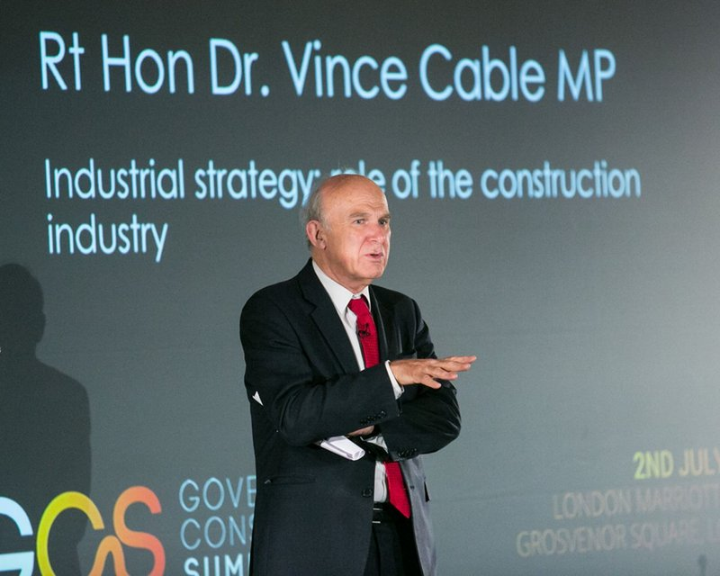 Vince cable puts his views to the audience at the Government Construction Summit.