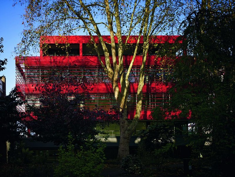 A new set of louvres wraps south and south-east facades, seen here from the neighbouring patch of park.