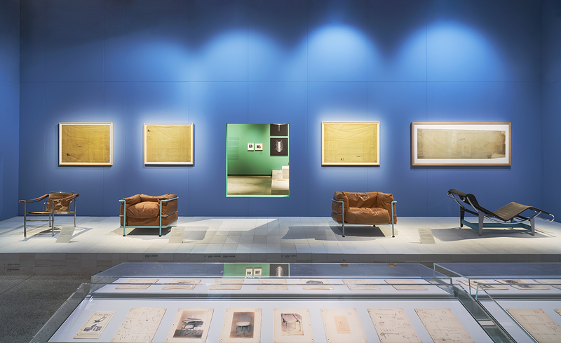 Exhibition installation shot of Charlotte Perriand: The Modern Life at the Design Museum.  Series of tubular steel furniture with manufacturing plans designed by Le Corbusier, Pierre Jeanneret and Charlotte Perriand (Centre Pompidou, Paris National Museum of Modern Art – Centre for Industrial Creation and Vitra Design Museum.)