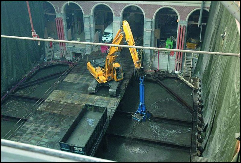 All the soil excavation was done below Amsterdam's shallow water table. Once dug,the underwater concrete was pumped in to create the floor of the new basements.