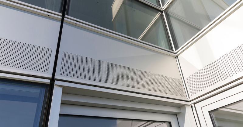 Renson Invisivent thermally broken window ventilators at Providence Tower, Isle of Dogs. The vents sit behind the perforated facade panels.