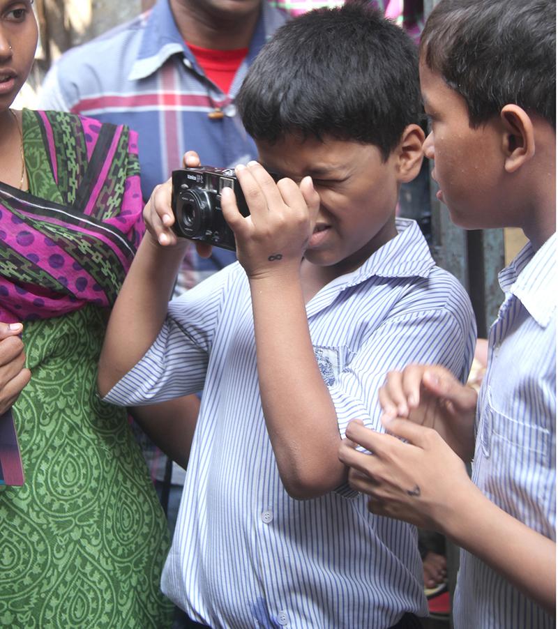 The class document their neighbourhood during a Walkabout workshop, 2014.