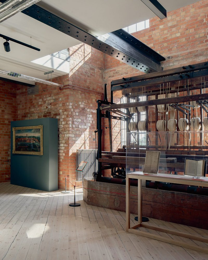 The mill's existing structure is revealed and sensitively adapted, with filtered daylight a welcome bonus.