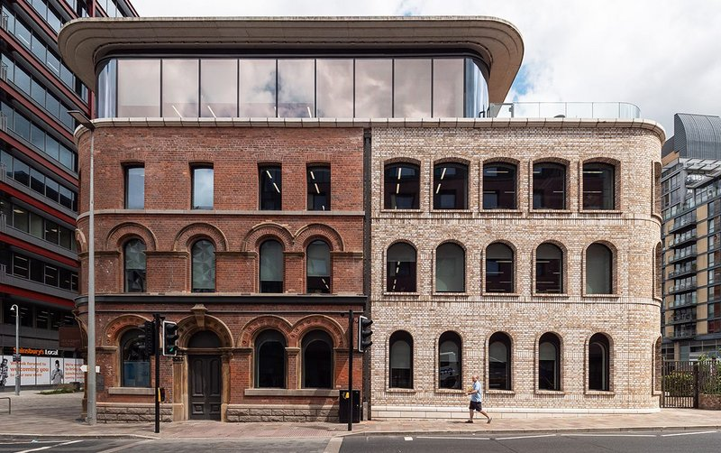 The Royal Veteran Tavern reborn as Riverside House, Salford: Restoration of the 19th-century brick facade (on the left) alongside construction of a new Category A office building (right).