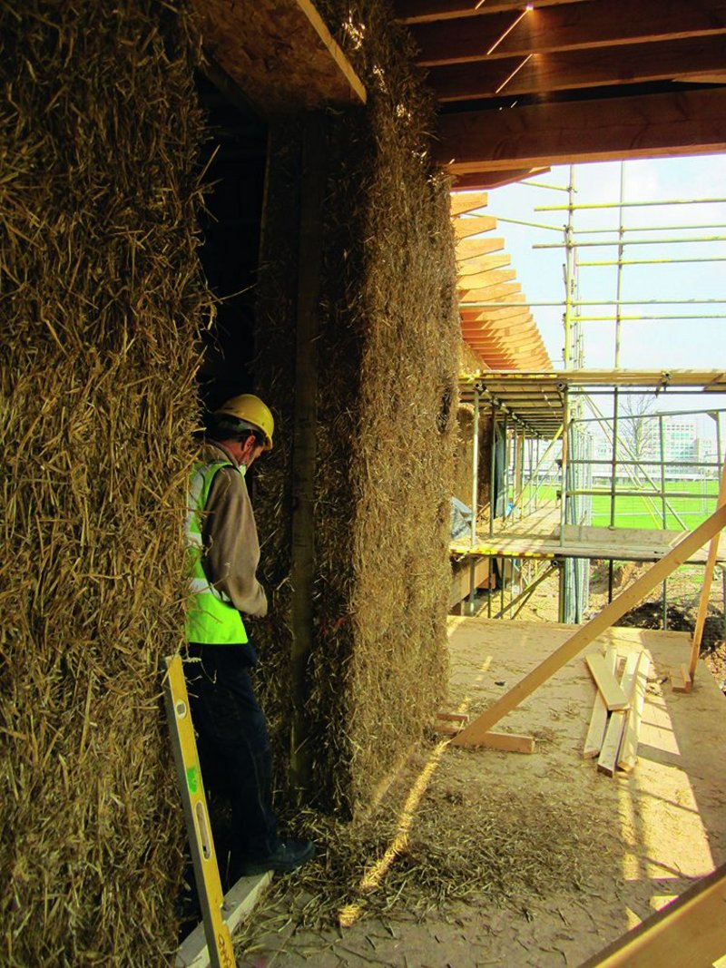 Straw bale wall under construction
