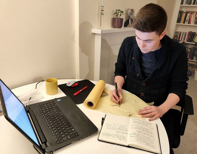 Daniel Anderson, a student at Edinburgh School of Architecture and Landscape Architecture (ESALA), prepares a sketch for a final project by hand.