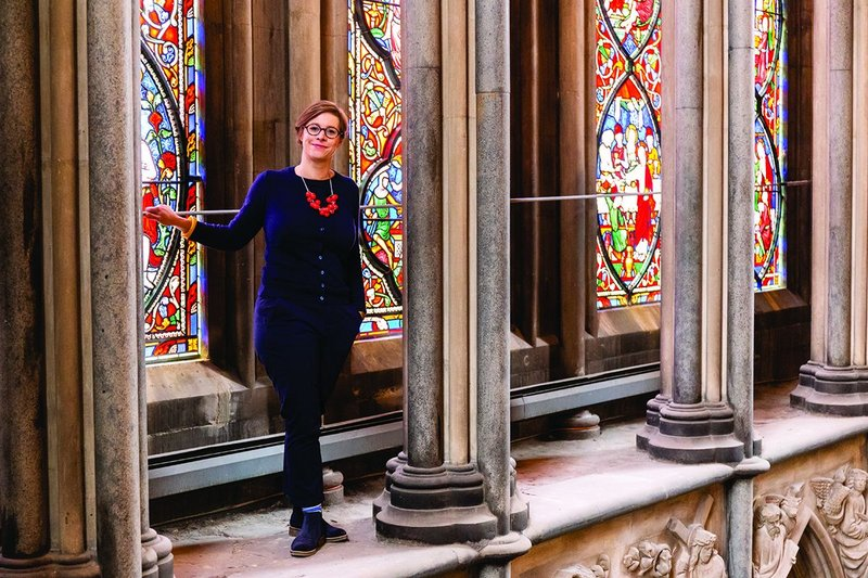 Camilla Finlay at Worcester Cathedral's east window. As surveyor to the fabric she has the keys and codes for the hidden spaces.