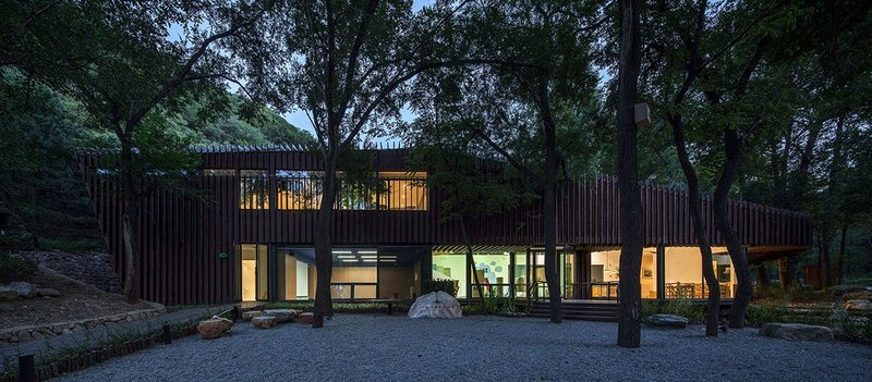 Badaling Forest Experience Center, Beijing. Great care was taken to design around the trees on the site rather than remove them. Photo: Zhangyong. © Courtesy of BCKJ Architects