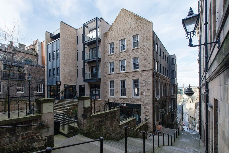 Stitched in between Roxburgh and Warriston's Close,  the serviced apartments use a variety of materials: stone, metal cladding, and render to break up scale. Restaurants face the small square and the steps down to Waverley Bridge.