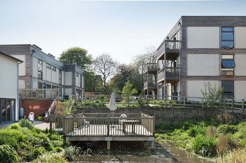 Low Impact Living Affordable Community (LILAC) in Leeds was able to prioritise pedestrian and child-friendly spaces, as designed by White Architecture.