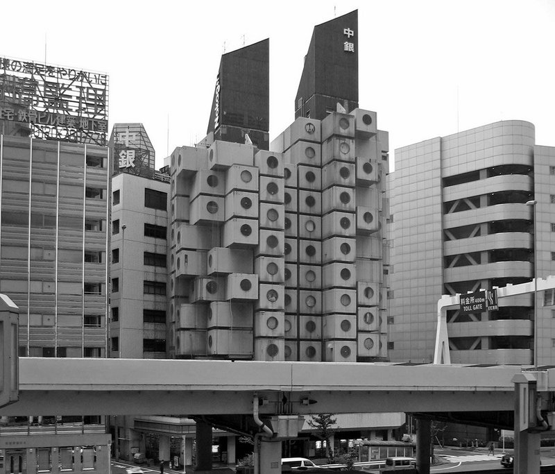 Kisho Kurokawa's Nakagin Capsule Tower, Tokyo, 2013. The 1972 building is a testing ground for demolition or rehabilitation.