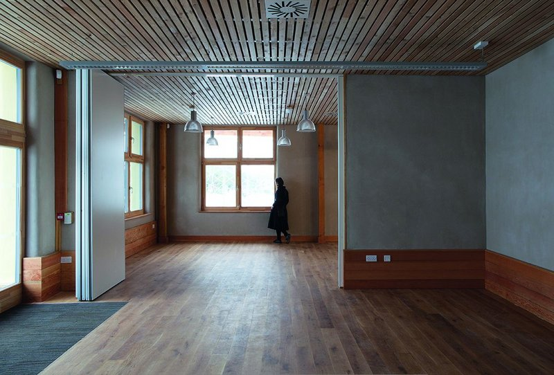View looking east from the community room through partitions to the café