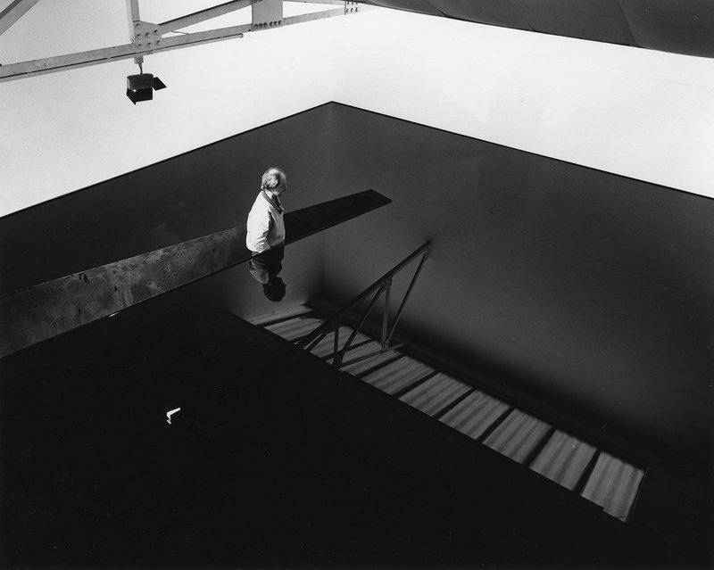 Richard Wilson, standing in the original installation of 20:50, Matt's Gallery, London, 1987.