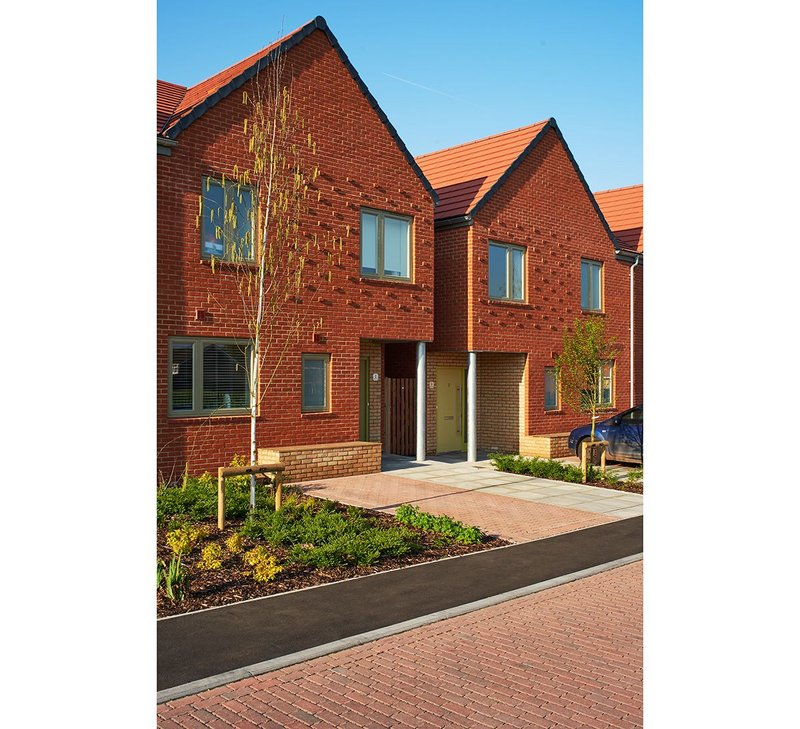 The basic brick backdrop of Umpire View by Sarah Wigglesworth Architects is added to by a projecting brick pattern on the gables.