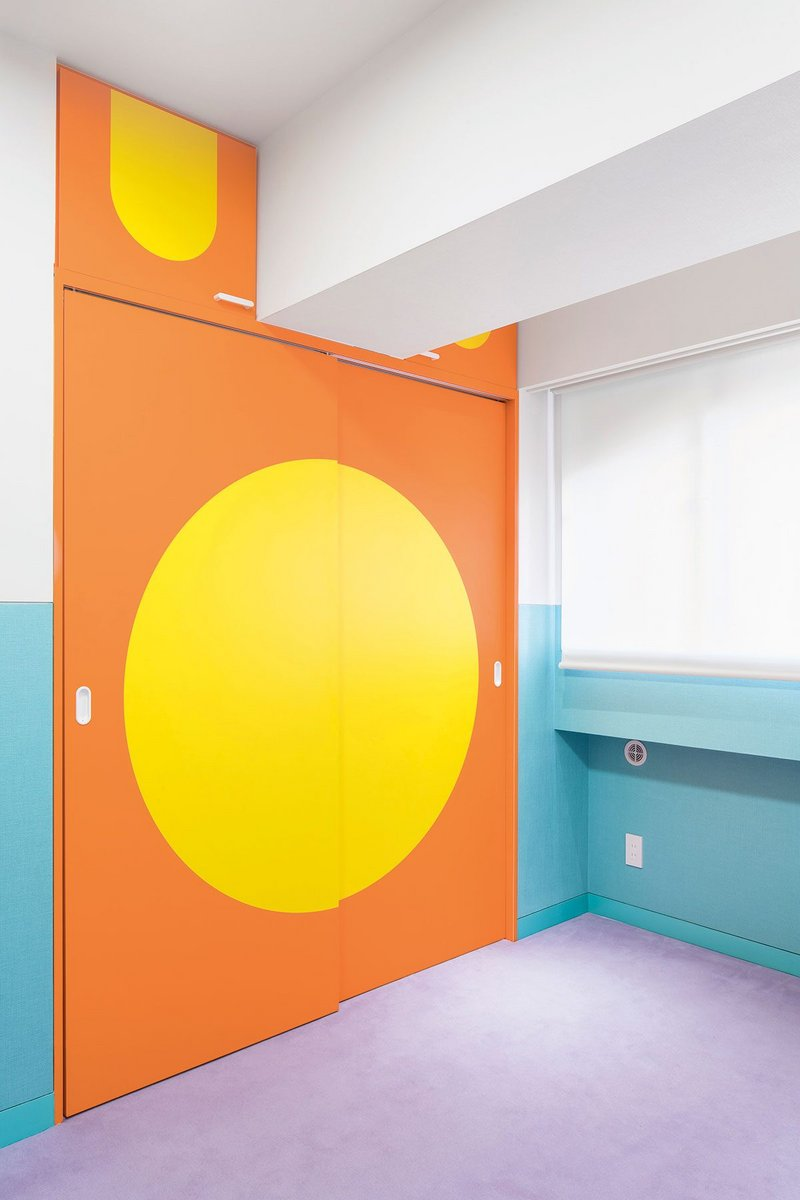The Japanese 'Hinomaru' flag inspired the brightly coloured sliding screens between rooms.