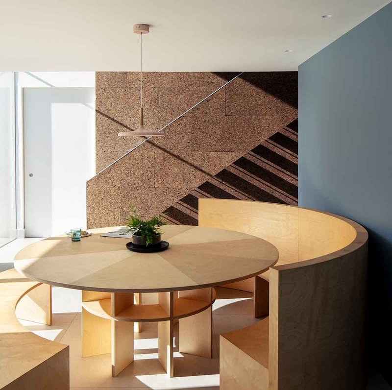 The bespoke dining table and cork clad staircase were designed by Guttfield Architecture.