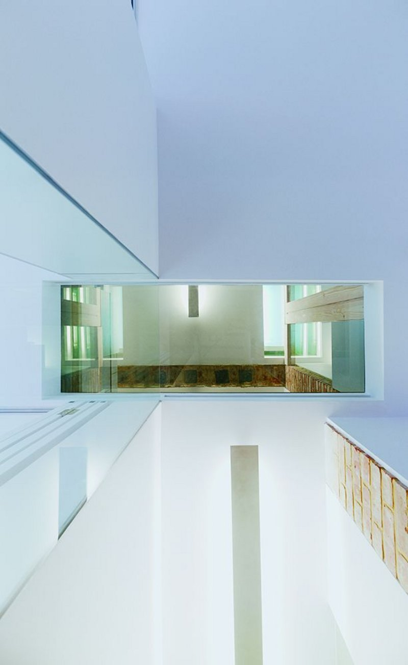 Vertical (shown here) and diagonal views are opened up through the house.