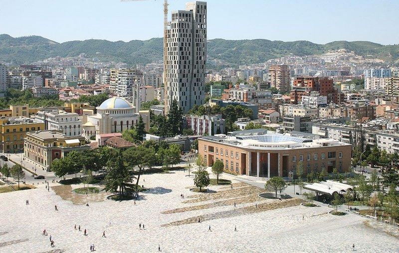 Skanderbeg Square looking south east. Unifying various ministries and public buildings around it, the reinvented square is more monumental yet more humane than in its former iteration.
