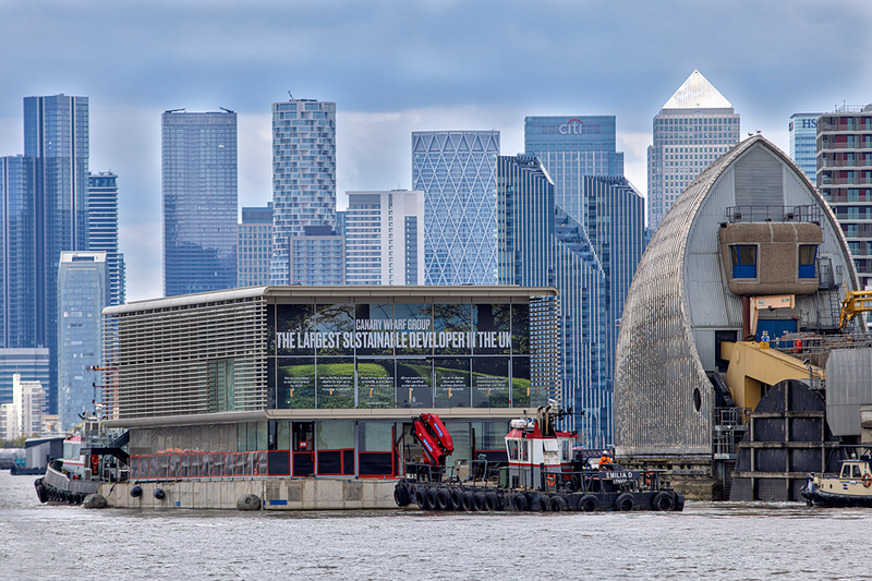 The pavilions were pulled by tug from the construction site in Beckton, via the Thames Barrier and Greenwich to Canary Wharf