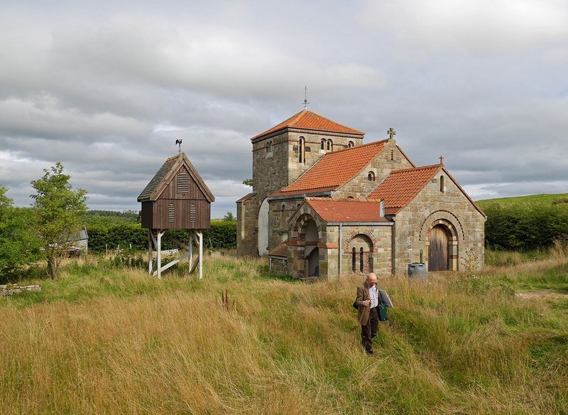 The chapel of Shepherd's Law in Northumberland recalls an earlier age and is still a work in progress. Architect Ralph Pattisson paces out the site. To the left is the incomplete but functioning bell tower.