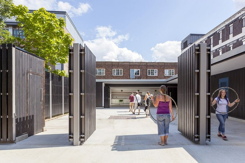 The Rickyard, updated as a community learning centre, opens onto the park.