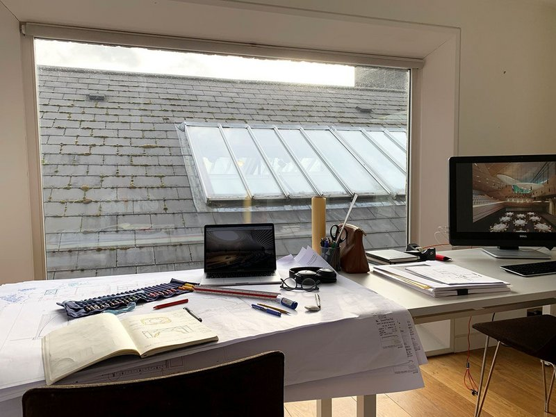 Seilern's home workspace overlooks the living room roof and skylight.