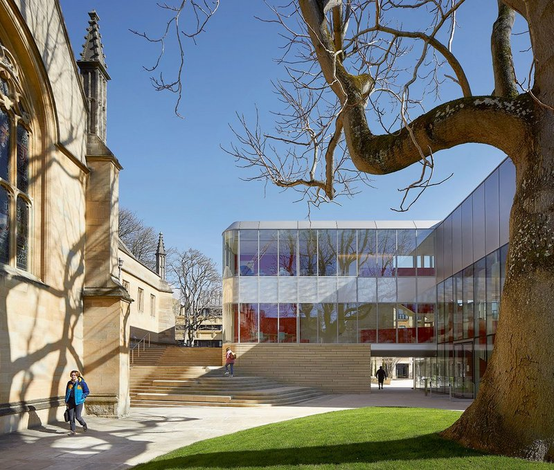 The building brings a sense of openness, through its central knuckle and around the edge where a generous flight of stairs links first-floor terraces to the Back Quad.