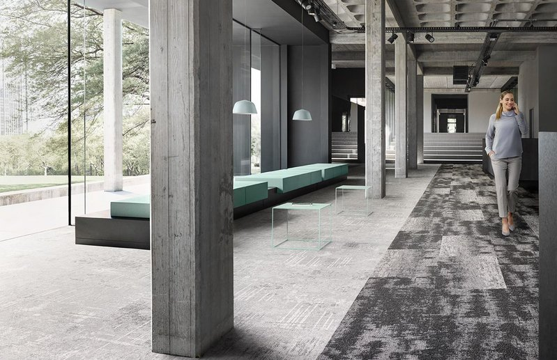 Desso carpet tiles by Tarkett can be used to zone spaces and signal a change of function.