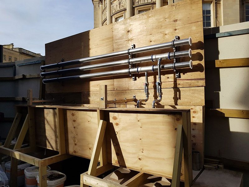 A full-scale mock-up of the pipework system and Great Drain constructed outside the abbey.