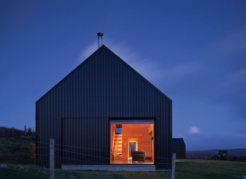 Barn-like and lit up at night.