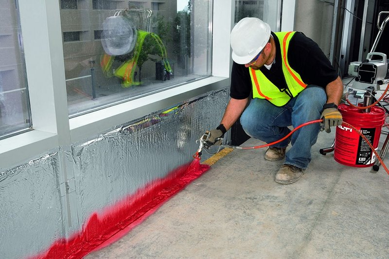 Hilti's CFS-WB Firestop joint spray, sealing perimeter gaps between floor slabs and curtain walling systems or wall junctions with soffits of concrete or composite slabs.