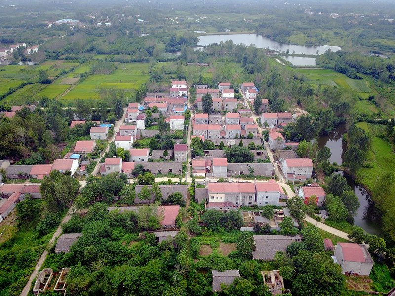 Aerial view of Shigushan village with commune housing gradually replaced by contemporary family houses, 2017.