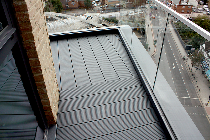 The Ryno non-combustible aluminium decking system on a balcony and terrace at Peabody's Williamson Heights in Wembley, London.