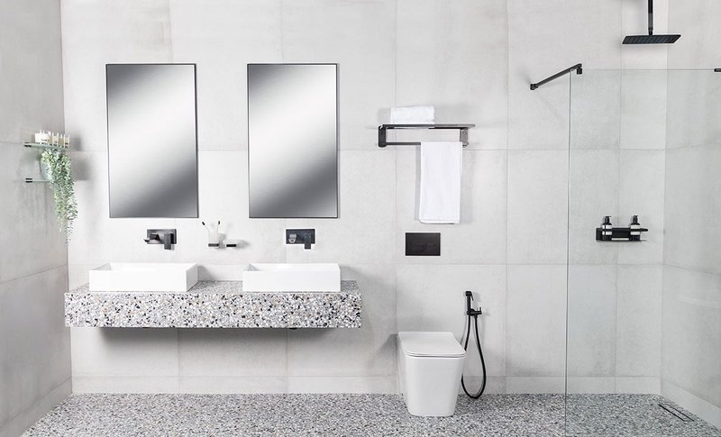 Stratos countertop washbasins with Zephyr mixer taps, WC and showerhead, the Bagnodesign collection, Sanipex Group.