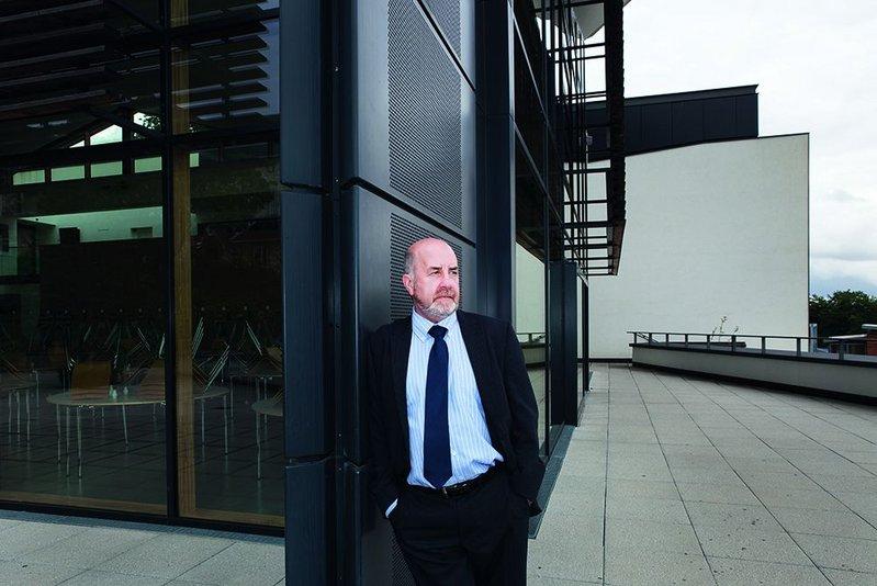Tommy Geddes leans against Design Engine's Student Centre