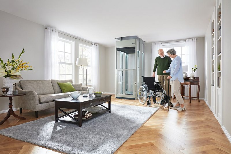 Stiltz's Trio+ Home Lift installed in a living room is suitable to carry three people or a wheelchair user.