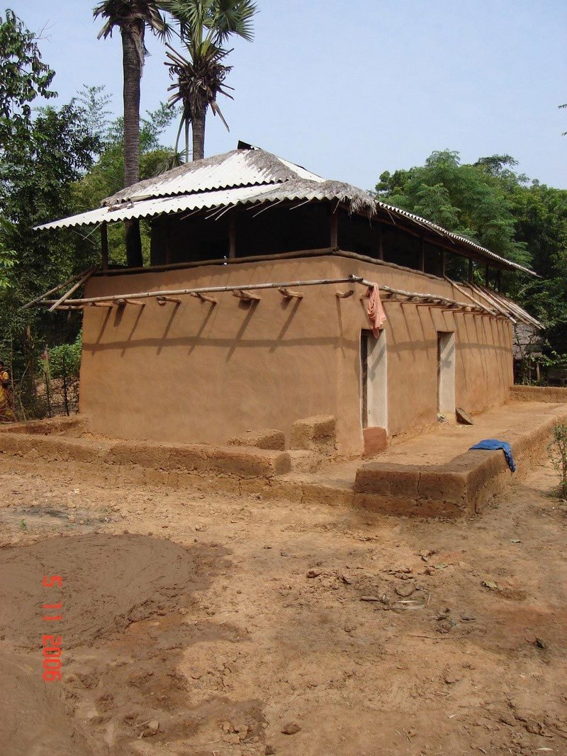 A traditional earthen dwelling in West Bengal, India, that follows a centuries old 'Samthal' style of construction using only local skills and resources.