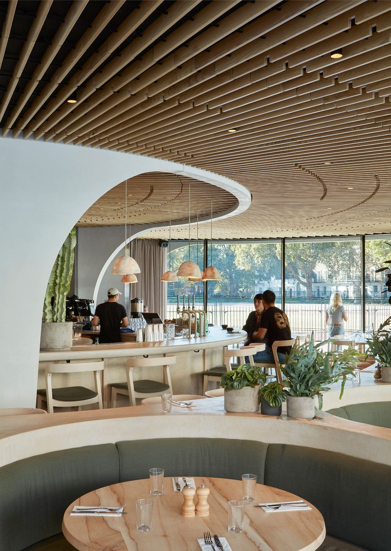 A warm ash ceiling radiating out from the quartz concrete core sets the stage for Nex's version of café society.