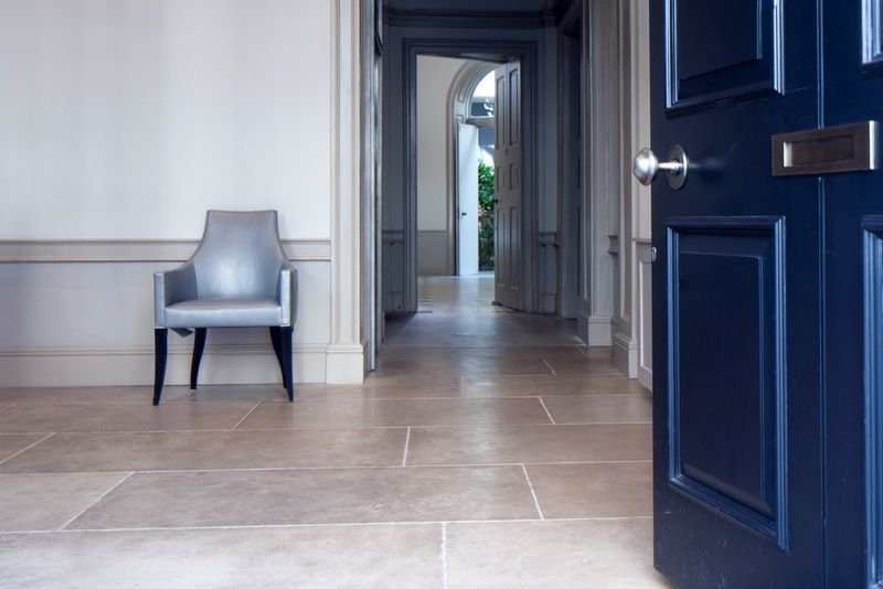 Portland Limestone floor with bespoke patinated finish and 750mm width courses at residential property in Mayfair, London