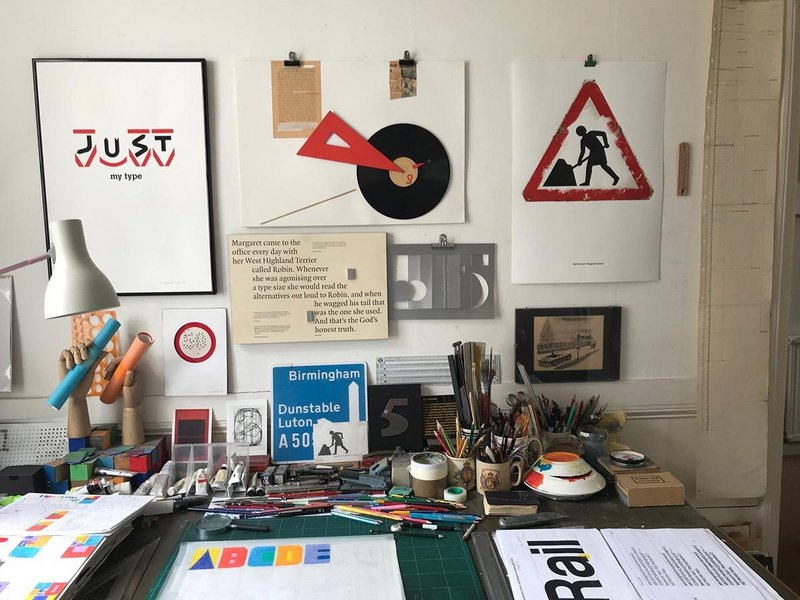 Margaret Calvert's studio from the Margaret Calvert - Woman at Work exhibition at the Design Museum. Her self portrait, a customised version of the road works sign is above right.