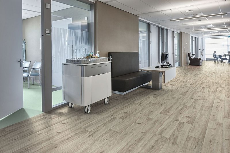 Forbo's new Eternal collection offers  an extensive range of finishes, all with realistic wood effects, stone and abstract designs. Eternal Colour in Aqua 40562 and Eternal Wood in Cream Oak 10842.