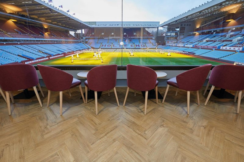 Amtico's Spacia 36+ Featured Oak luxury vinyl tiles fitted in a large parquet laying pattern at Aston Villa Football Club.