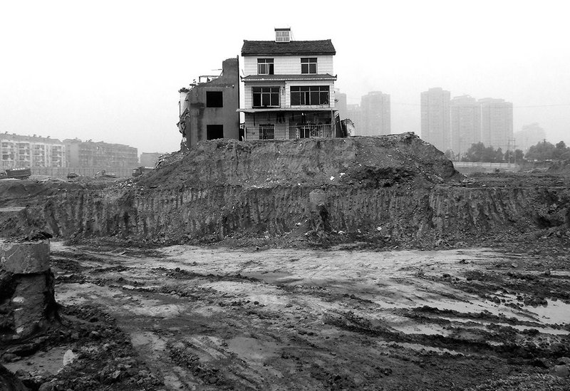 'Nail house' marooned in Yichang, China, 2013.