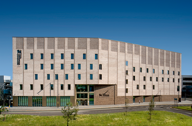 The building's brick envelope provides a protective castle around the sound- sensitive interior.